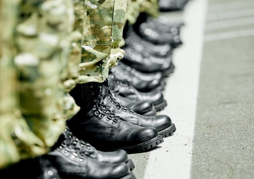Soldiers standing in a row, photo of their legs and boots