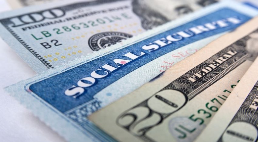 Close up image of American dollar bills and Social Security card