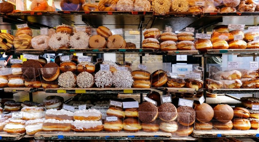 Photo of various donuts on a shelf