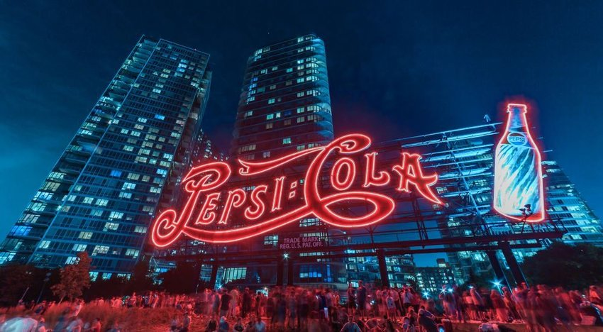 Photo of an illuminated neon Pepsi-Cola sign