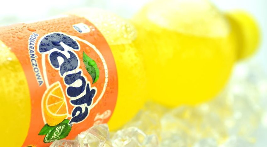 Close up photo of a bottle of orange Fanta soda
