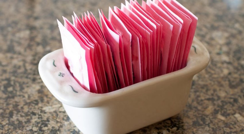 Photo of pink sugar packets in a bowl