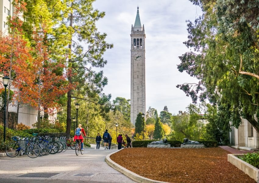 Tower, landscaping, and students on campus at University of California, Berkeley