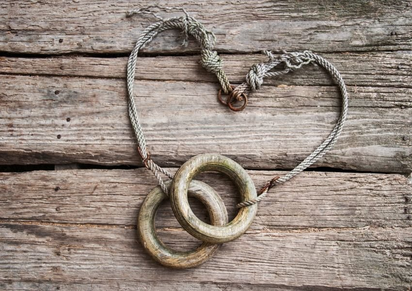 Image of old wooden rings attached to string in the shape of a heart