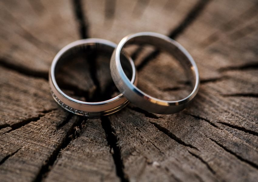 Two wedding bands on top of wood