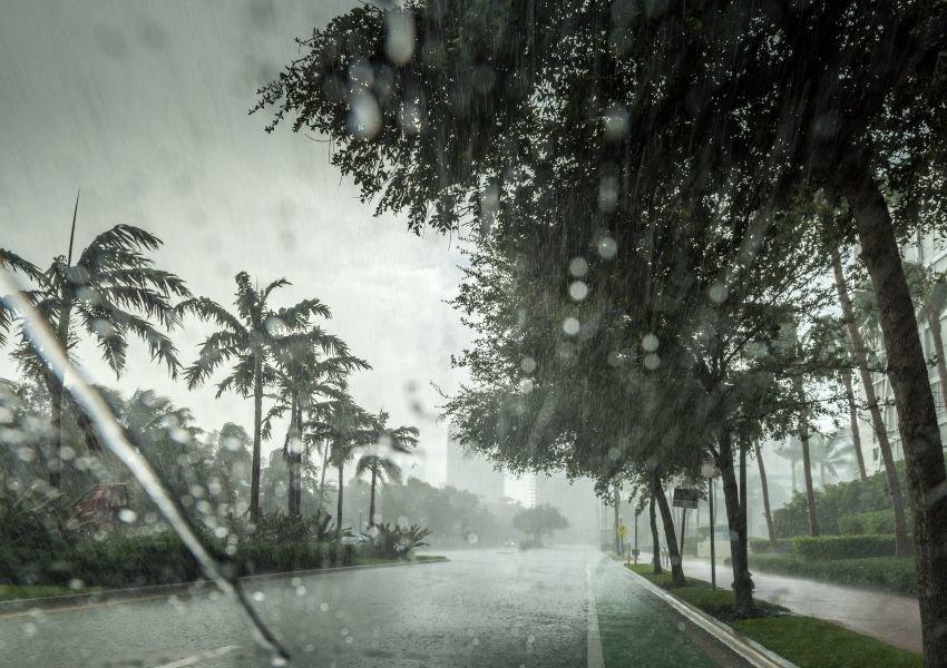 Tropical road with heavy rain