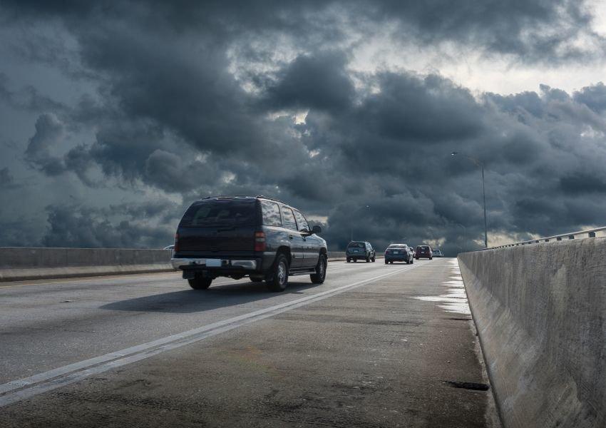 Dark clouds over a road