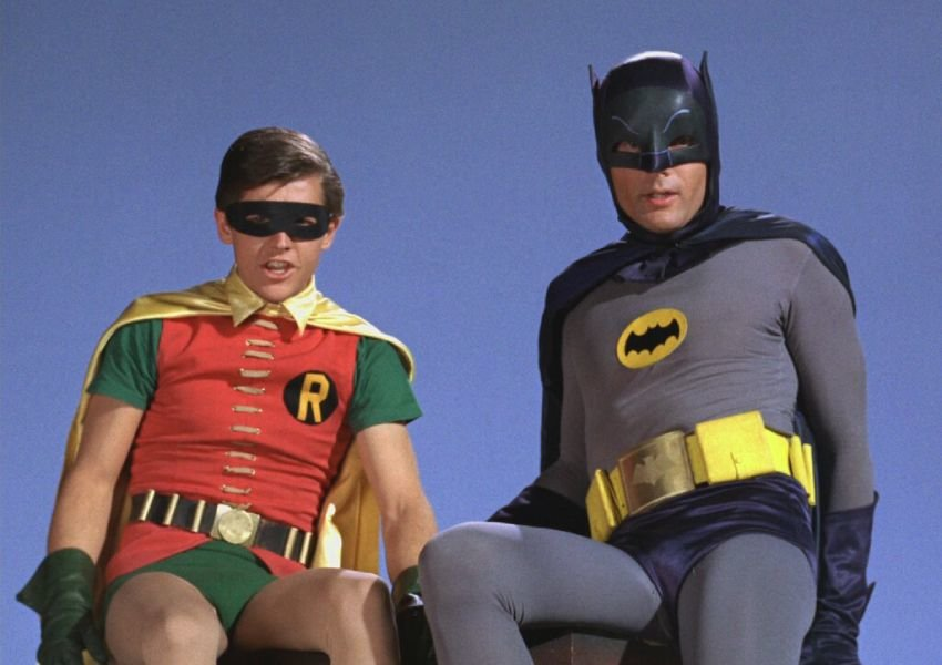Actor Adam West in Batman costume with another actor playing Robin