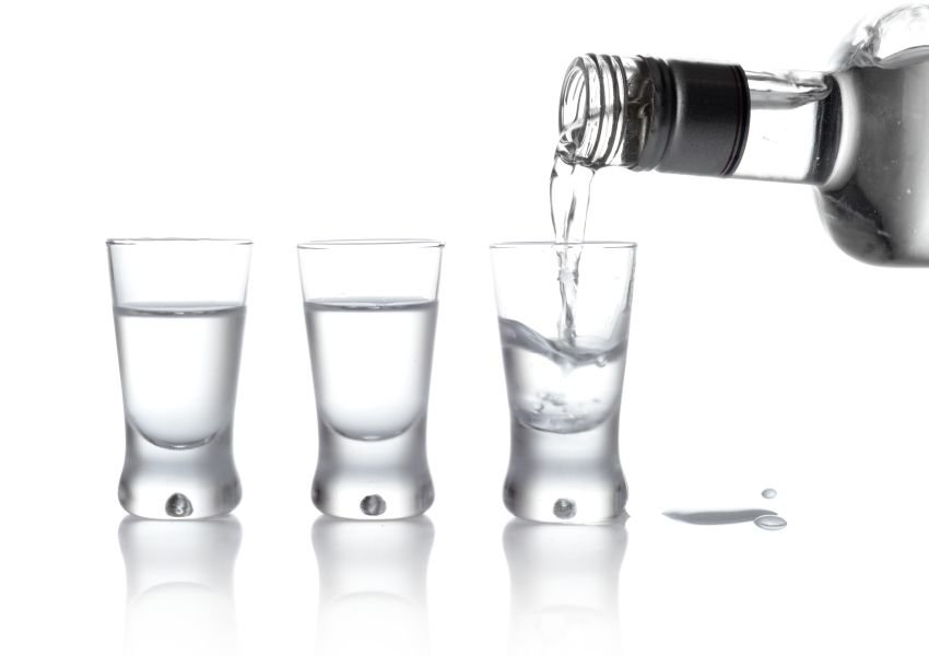 Shots of vodka poured