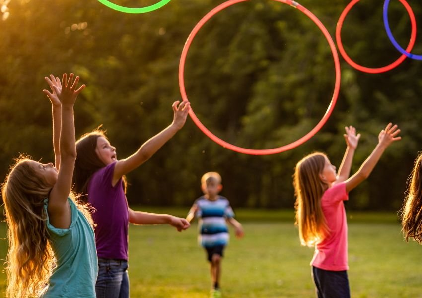 Photo of children playing with hula hoops