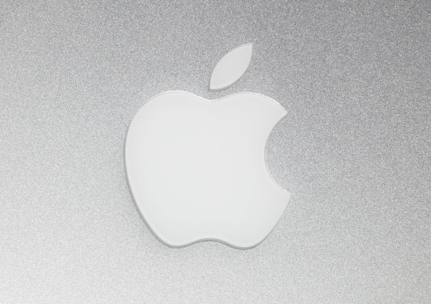 Photo of the Apple logo on a gray background