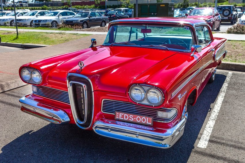 Image of bright red Ford Edsel in a parking lot