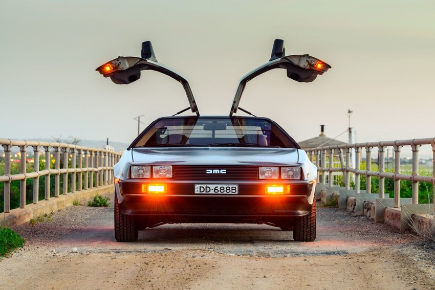 Image of the DeLorean DMC-12 on a bridge, with doors open