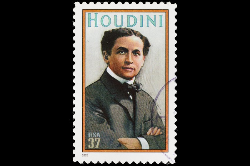 A stamp printed in the U.S. in 2002 shows Harry Houdini with his arms crossed