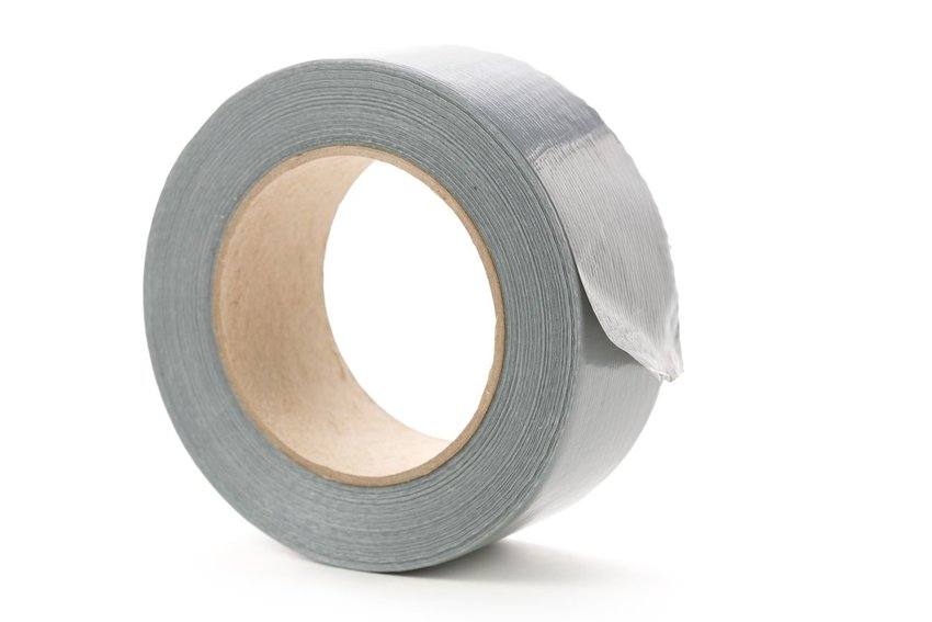 Roll of grey duct tape on white background