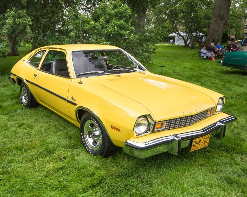 Image of a yellow Ford Pinto car in a grassy field