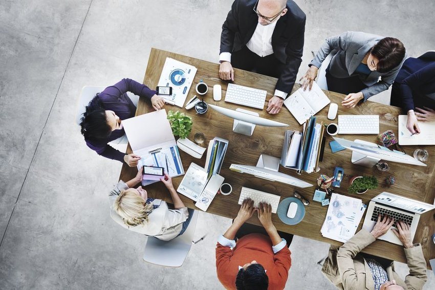 Overhead photo of people working on computers at a table