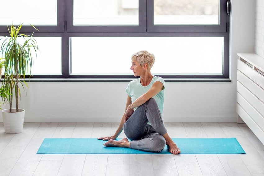 Photo of a woman doing yoga at home