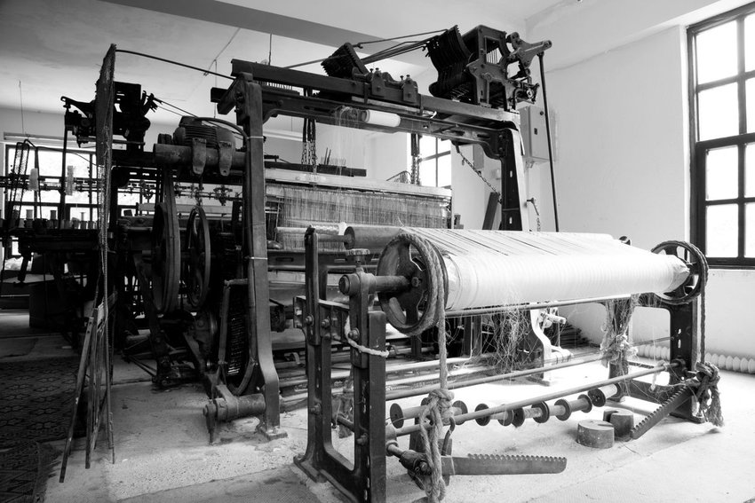 Black and white photo of an old industrial machine