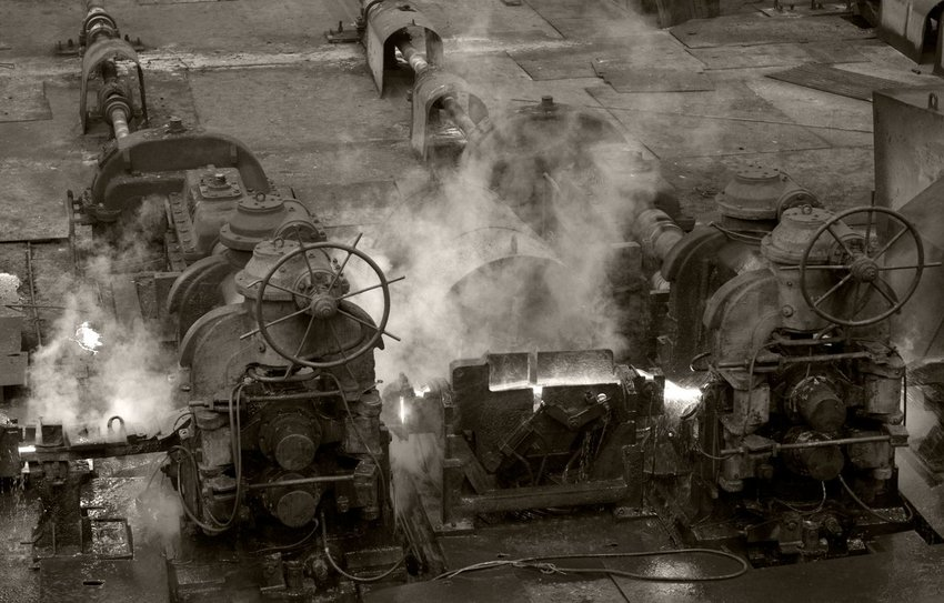 Black and white photo of old steam engines