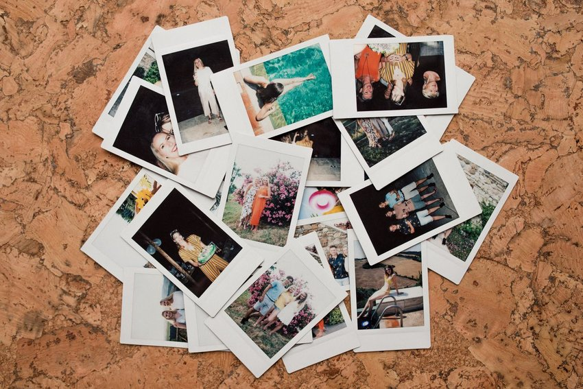 Photo of a pile of Polaroid instant photographs