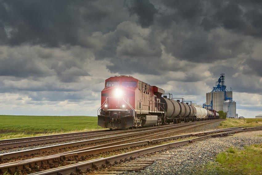Photo of a train crossing farmland