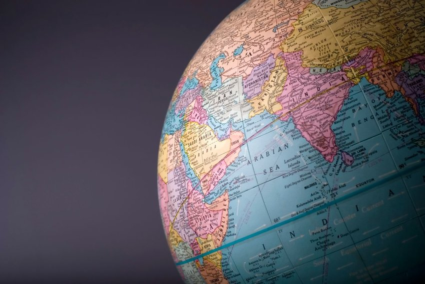 Close-up photo of a globe displaying Africa and Asia