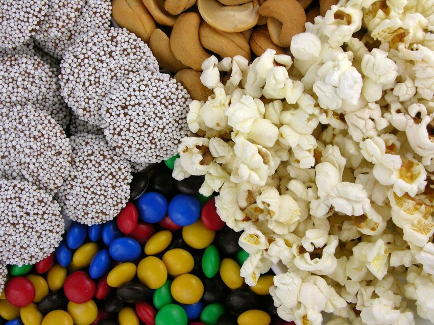 Photo of popcorn, candy, and nuts