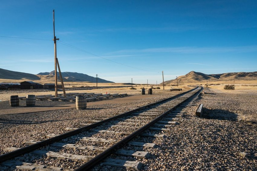 Photo of train tracks in the desert