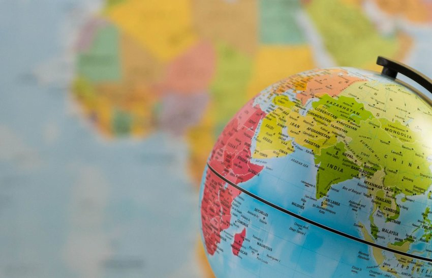 Photo of a globe in front of a map
