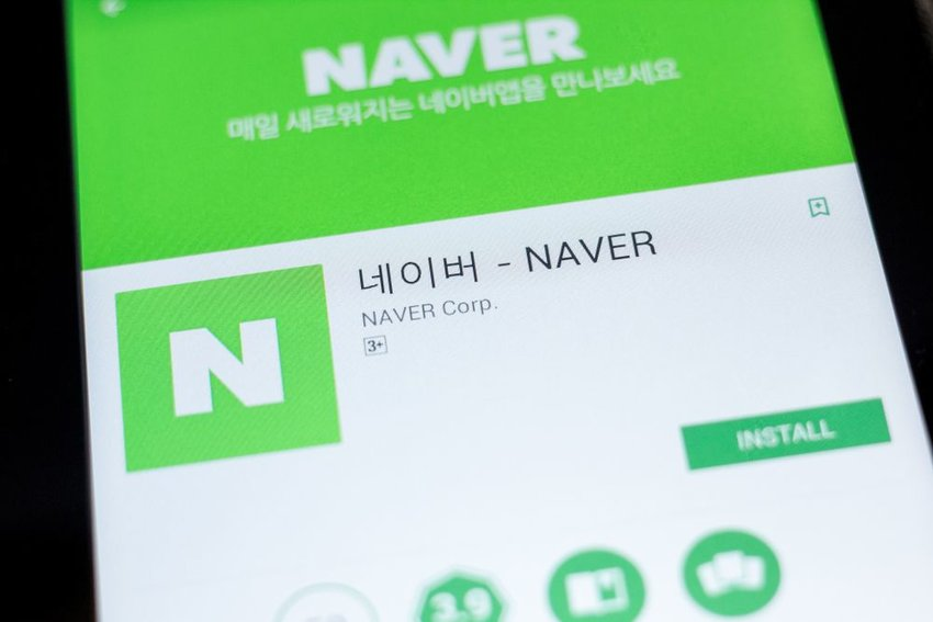 Up close view of tablet showing the Naver logo and download screen on app store