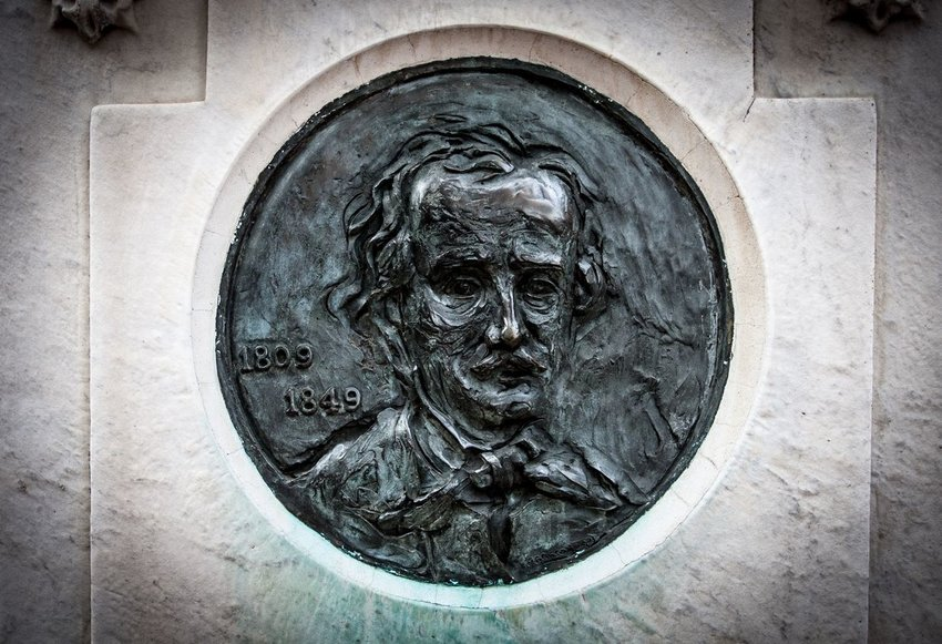 Photo of a plaque carved with Edgar Allan Poe's face