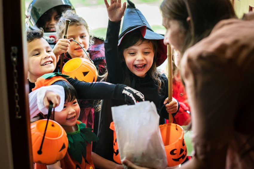 Photo of children in costume trick or treating
