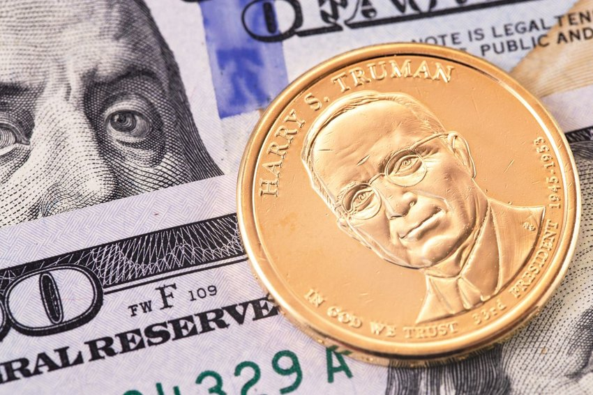 Up close view of U.S. currency and Harry S. Truman golden dollar coin