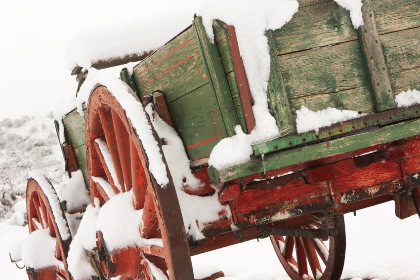 Stagecoach wagon covered in snow and ice in the middle of winter