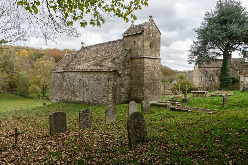 Photo of an old church and graveyard