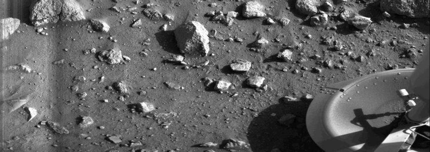Gray photo showing Mars rocks and space lander, the first photo ever taken on the surface of Mars, July 20, 1976