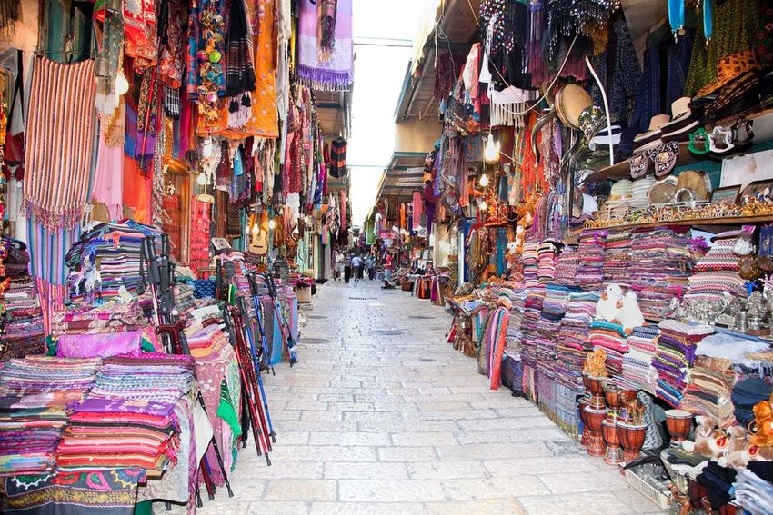 Open air market in Jerusalem, Israel, with assorted garments and silk trade products