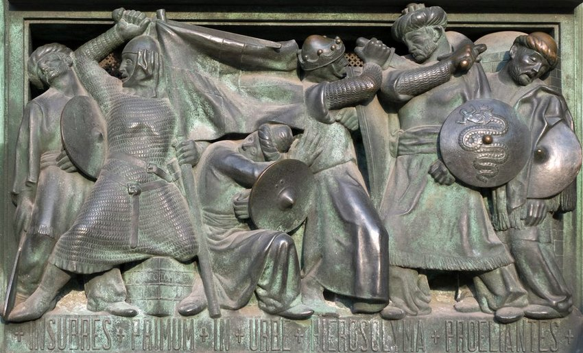 Stone relief in cathedral door showing soldiers fighting during crusade era