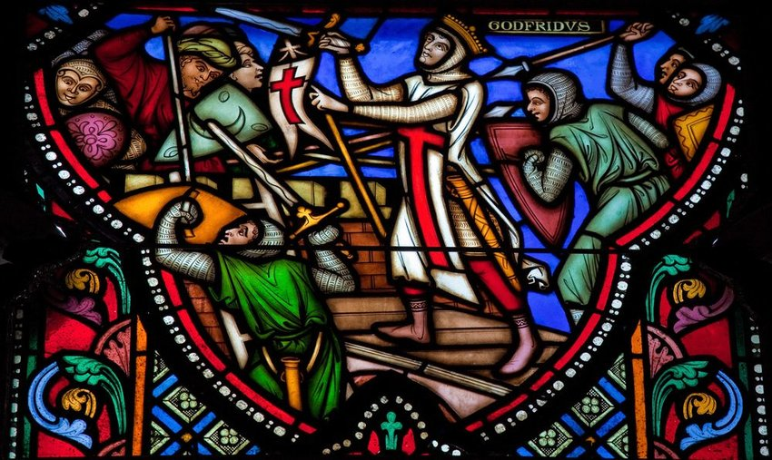 Up close view of stained glass window showing crusades at the cathedral of Brussels