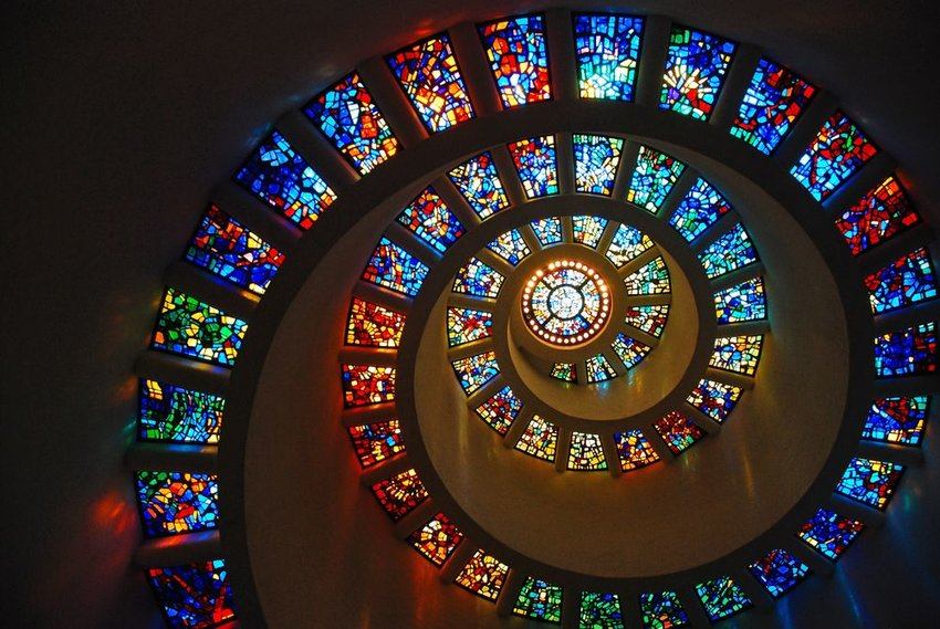 Spiraling stained glass windows rising in the golden ratio at a chapel in Dallas, Texas