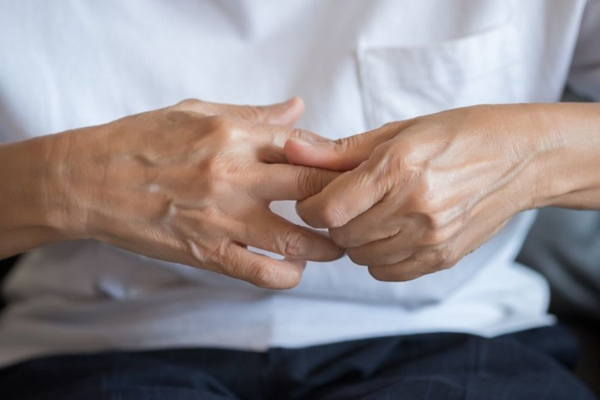 Up close view of a person's hands clasped together