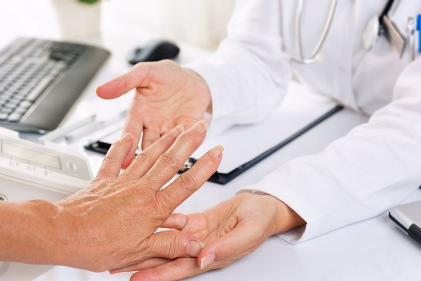 Doctor examining someones hand