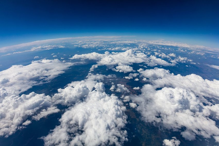 High aerial view of earth's curvature seen from above the clouds