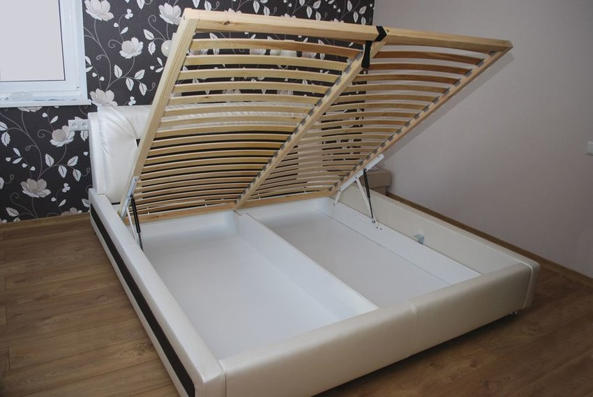 Utility bed with storage space available underneath wooden slats