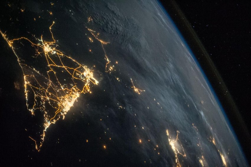 View of Earth curvature and lights at night seen from the International Space Station