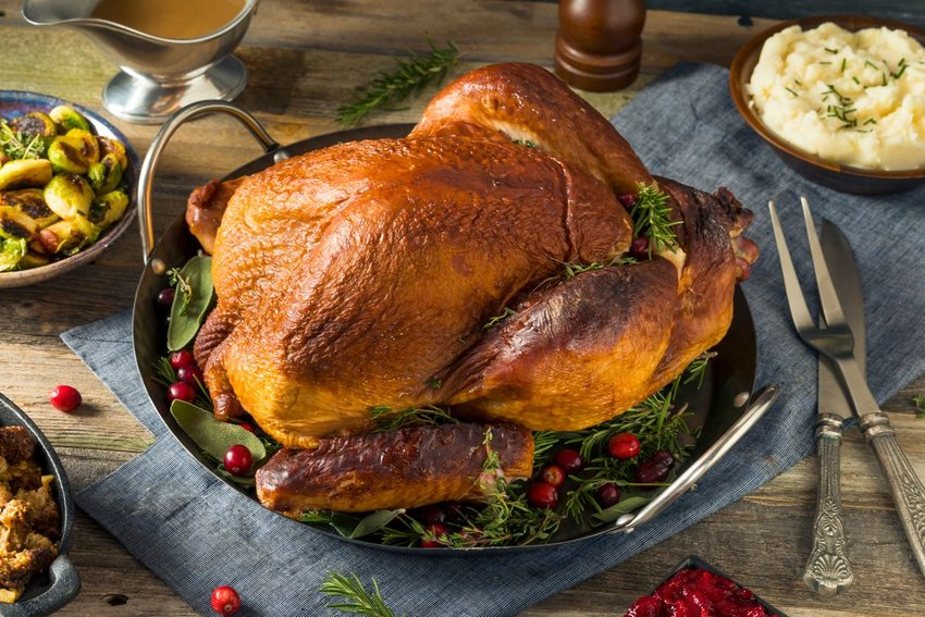 Roasted turkey served on a tray for an elaborate Thanksgiving feast