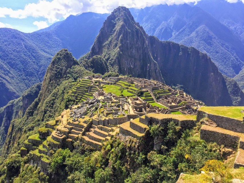 Aerial view of Machu Picchu architecture and landscape with mountains in background