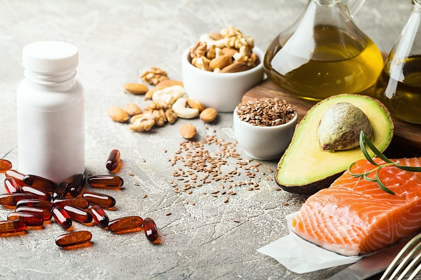 Assortment of heart-healthy fats, nuts, seeds, and omega-3 capsules