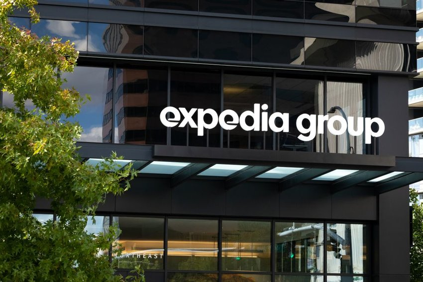 Expedia Group building with white signage and trees, Bellevue, Washington
